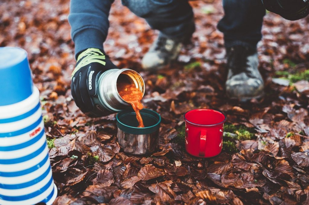 Flask of soup eaten outdoors